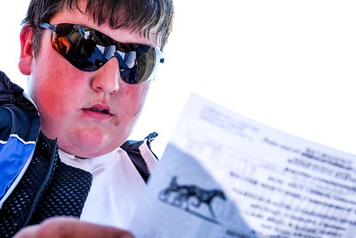 Prep Time: Zack Gray studies the program before his first parimutual drives yesterday at the Topsham Fair.  More photos from the day on Brewster's Photos under recently added galleries.