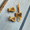 Harp Lager lapel badges (2 here, 1 more) and a Harp tie clip