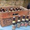 Two wooden Courage Barclay Simonds crates containing Imperial Russian Stout in bottles