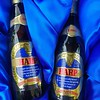 Two presentation bottles of Harp Lager brewed to commemorate the opening of the new brewery at Park Royal, London