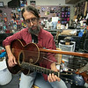 Eddy Troxler the owner of Eddy's Music in Fitchburg shows off the 1918 Gibson U Harp Guitar he just recently got into his shop. SENTINEL & ENTERPRISE/JOHN LOVE