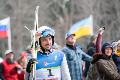 KELLY FLETCHER, REFORMER CORRESPONDENT - Brattleboro local, Spencer Knickerbocker, walks through the crowd after completing his jump at Harris Hill on Sunday.