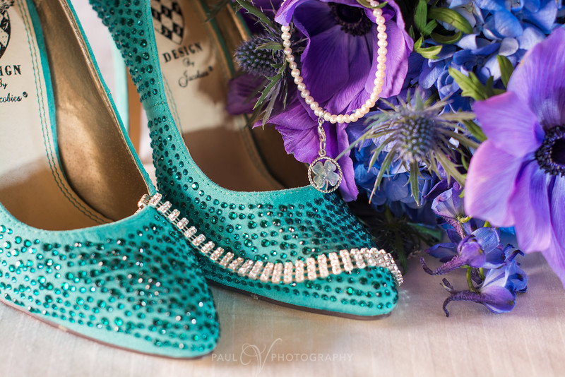 Turquoise and Purple Shoes and Flower s around 4 Leaf Clover