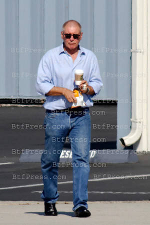 Harrison Ford, bald head take off to Philadelphia with a guest in his private jet from Santa Monica airport in California