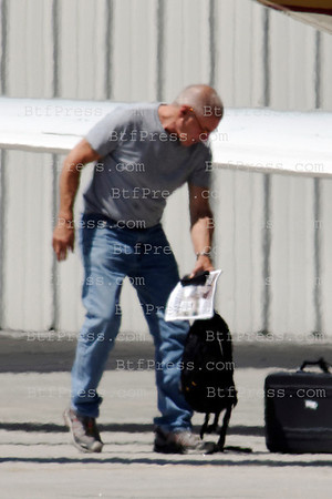 Exclusive- Harrison Ford bald head landing his private jet with guest in Santa Monica airport