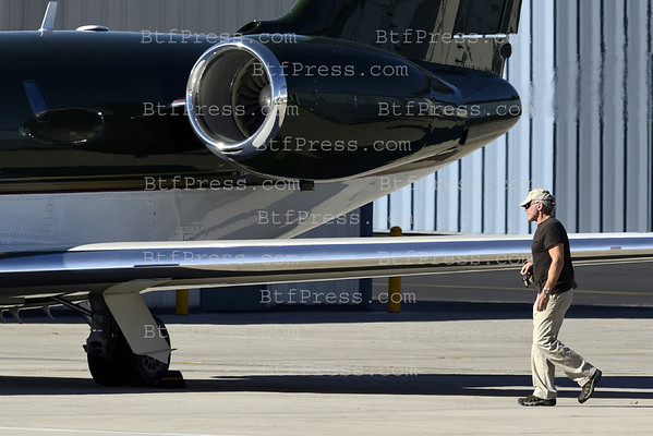 Exclusive: Harrison Ford, Calista Flockhart and son Liam take off from Los Angeles to Napa Valley in Harrison's Jet for the end of 2011.