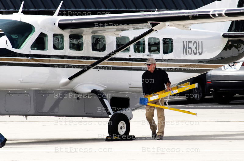 Exclusive___ Harrison Ford checks his plane and work in the turbine of his 2000 Cessna 12 seats before flying and also check his yellow and green 1955 Dehavilland in Santa Monica Airport,California.