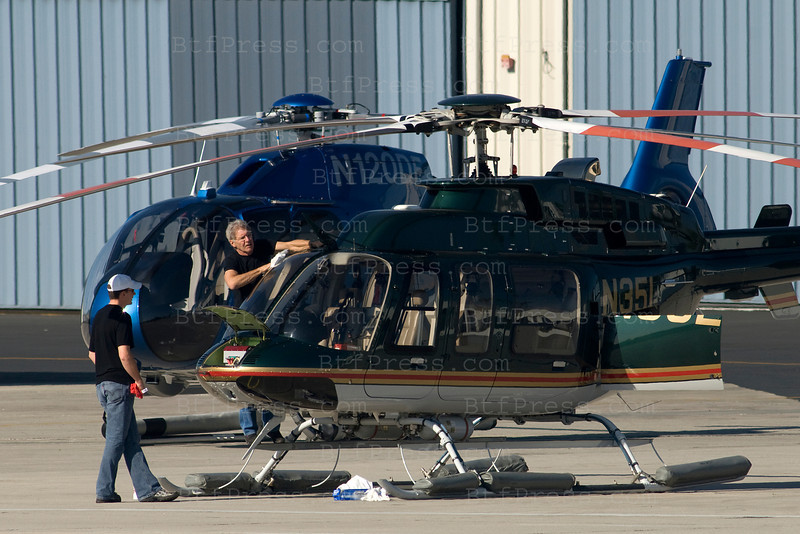 Harrison Ford cleans his helicopter before taking off. In Santa Monica, California on January 29, 2011