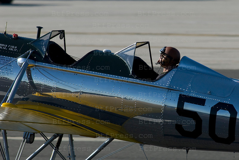 Exclusif--- Harrison Ford flies a Ryan PT22 plane from 1930 in Santa Monica,California. The Ryan PT-22 Recruit was designed in the MID 1930's and entered service in 1940 with the United States Army Air Corps, by the end of production 1273 aircraft had been produced and most remained in service until the end of WW2, consequently many of the US pilots of WWII learned to fly in these machines. Although primarily used by the armed forces of the US the Ryan PT-22 Recruit was also used by China and Ecuador as a military trainer.
