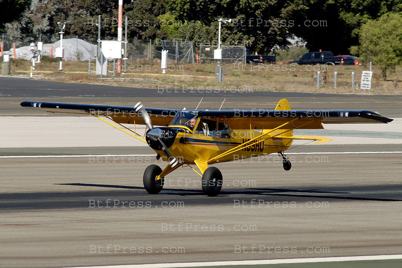 //e279ay0d2grizw551krjur2w1r.hop.clickbank.net/?tid=2P8NBB3Y Exclusive___ Harrison Ford makes a ride for a friend with his Indiana Jones yellow  Aviat Husky A 1C from Santa Monica airport California.