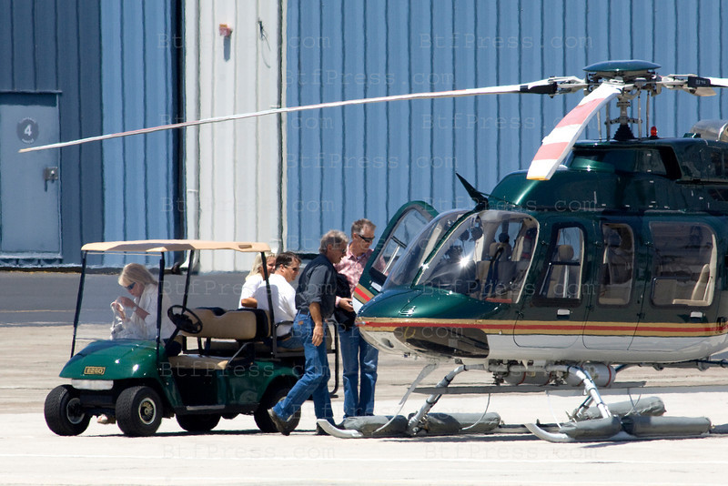 EXCLUSIVE--- Harrison Ford waiting a private jet with family and friend,after they land,they take off for four hours with Harrison's helicopter from Santa Monica Airport,California.