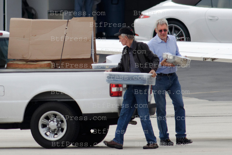 Exclusive___ Harrison Ford come back from east coast with a lot of Christmas presents, he need a pickup  truck to carry all of them, in Santa Monica Airport,California