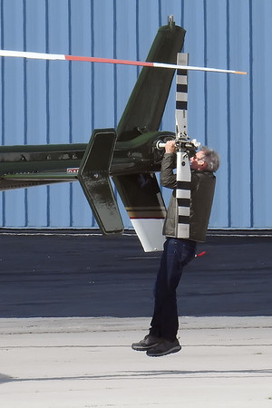 Harrison Ford is standing on his helicopter