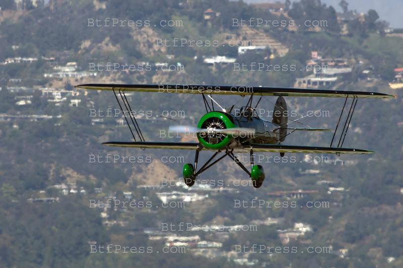 Exclusive------ Harrison Ford pilts his Waco Biplane in Santa Monica.