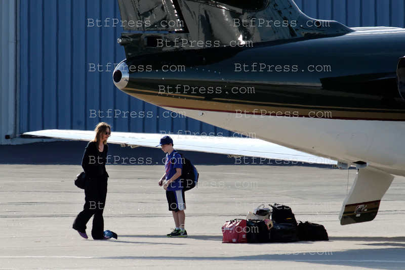 Exclusive__ Harrison Ford,Calista Flockart and son Liam come back to Los Angeles after a Weekend together.