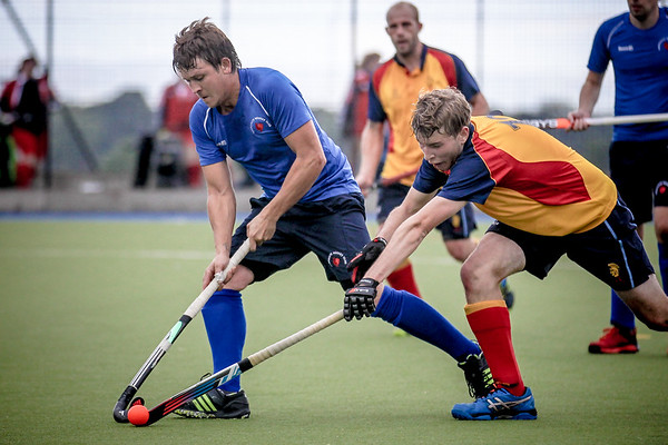 Steve Couture (Harrogate) takes the ball of the Lindum midfield player.