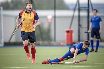 Will Rogers passes the ball out to the wing while falling, during the Lindum League game.