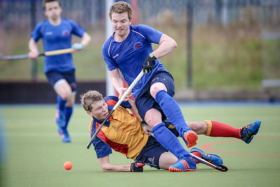Andrew Clemerson (Harrogate) keeps his feet while he is tackled heavily by the Lindum player.