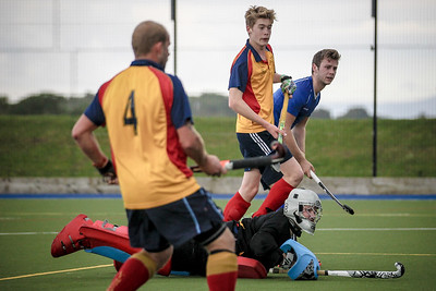 Charles Edmundson (Harrogate HC) and Lindum keeper watch as his shot goes in.