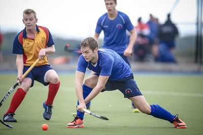 Charles Edmondson (Harrogate) shoots and scores in the second half to increase Harrogate Hockey Club's lead and secure the win.