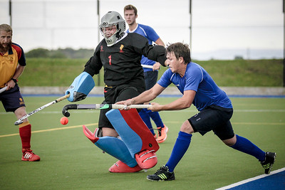 Steve Couture of Harrogate hits a reverse stick pass to Charles Edmondson on the back post during the Lindum league game.
