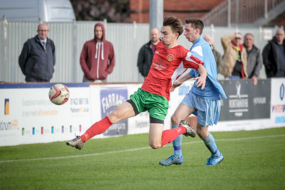 New player, Toby Lees gets to the ball ahead of the Parkgate defender.