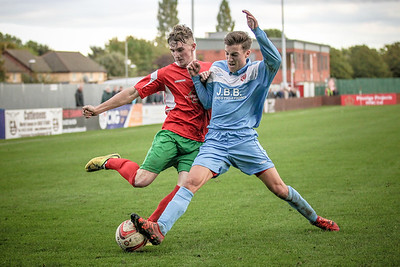 Ryan Sharrocks is challenged while trying to cross the ball. The Parkgate defender puts it out for a corner.