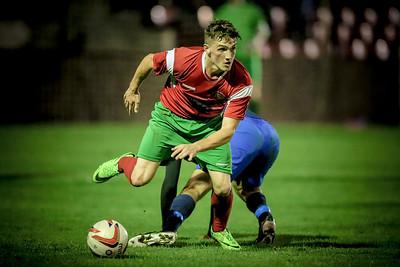 Ryan Sharrocks slips past the Worksop Town midfielder during the NCEL Premier League game.
