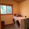 First floor laundry / mud room at 2nd front entry to home