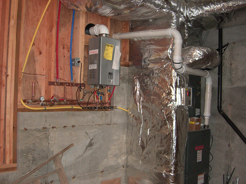 NEIL: AREA in the back of the garage is very tight.  Can't run make-up air there as it would have to go not only over support beams, but HVAC venting that is already dropping below the joists.