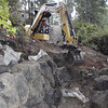Work started on the north side - the wall has been built in such a way that no nearby trees are damaged.  They are working on the ramp here.. underneath that bit of gray fabric near the bottom of the photo, where the 1st set of rocks are, is a big root from the madrona.