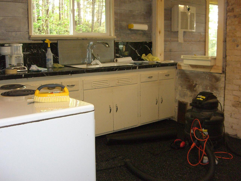 counters installed.  Found some cheap marble for about $2/sq. foot at a going-out-of-business sale.   Works for me, even if it is a bit darker than I wanted.   The backsplash behind toe sink is just some junk I found in our basement.  It's got a funky finish, but this is a weird cabin...