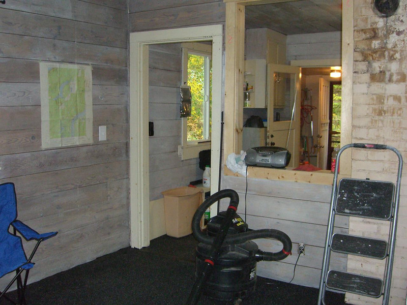 view from front room back toward kitchen and mud room / entry.
