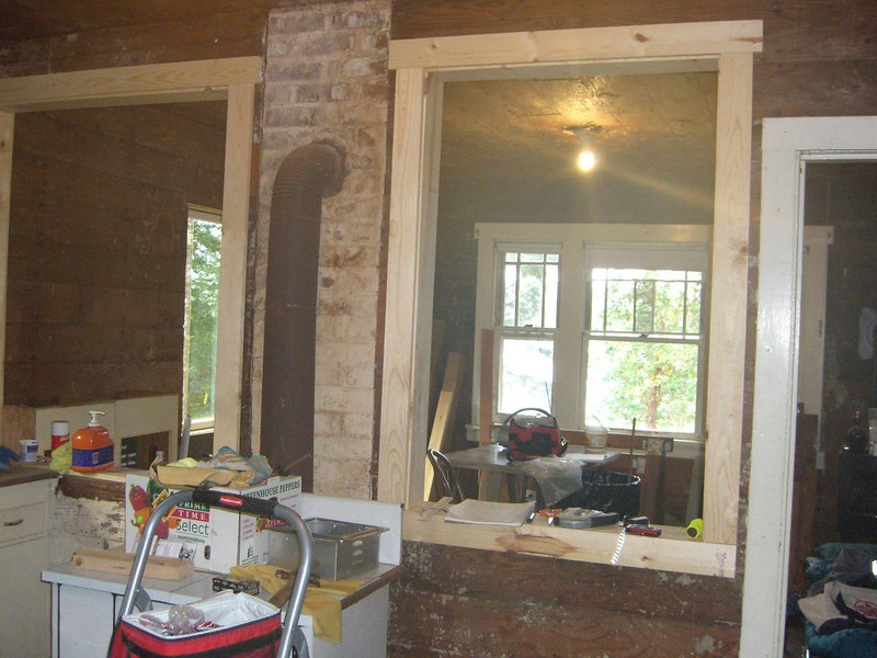 05 Here you see the two pass-throughs (feeding hatches) and the NEW window to the left.      Trying to open up the old place and get more light into it!