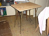 "09 - <br /> When the old formica table collapsed, the old legs were 'recycled"" to create this utility table."