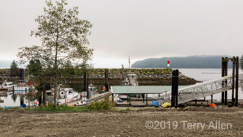 Hartley Bay ferry dock and breakwater on an overcast day, British Columbia