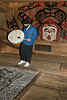 Gary singing and drumming in the longhouse, Hartley Bay, British Columbia