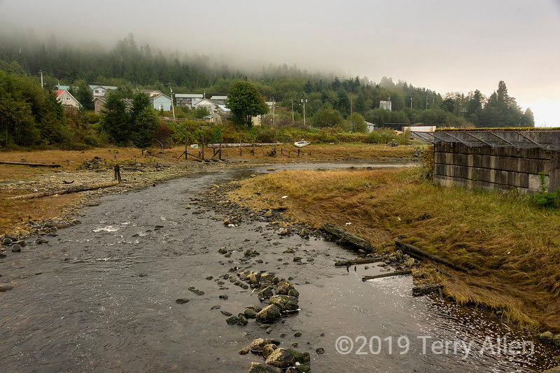 Looking towards the mouth of the Gabion salmon river past the helicopter pad, Hartley Bay, British Columbia