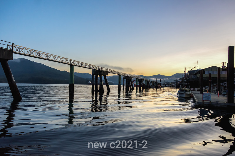 Silhouettes and ripples at sunrise, Prince Rupert Harbour, British Columbia
