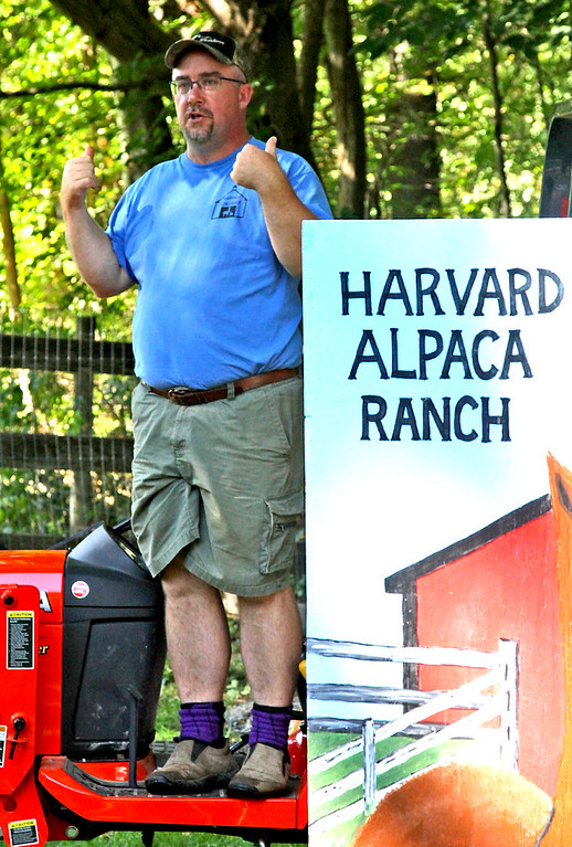 . One of the owners of the Harvard Alpaca Farm, Matthew Varrell, starts one of the tours of the farm in help celebrate the first year of operation. SUN Photo by David H. Brow