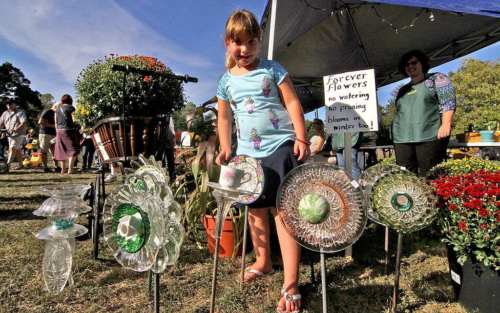. Young Katherine Berry,6, checks out glass flowers made from recycled plates and cups by the Harvard Garden Club, Katherine\'s mom is a member.Nashoba Valley Voice Photo by David H. Brow
