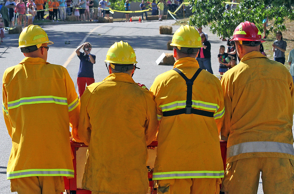 . The FireBalls Team made up of Harvard firefighters get ready at the start line in the annual Bed Races. Nashoba Valley Voice Photo by David H. Brow