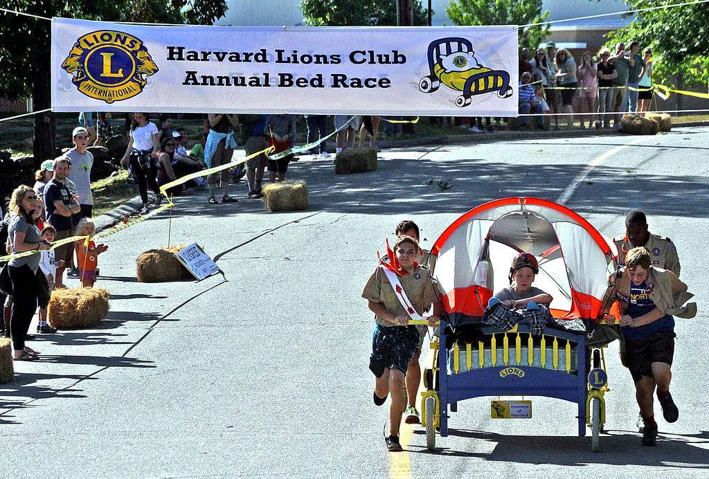 . Troop One Harvard Team make their way to the finish line in the annual Bed Races, the team is made up of Boy Scouts from Tp 1 in Harvard. Nashoba Valley Voice Photo by David H. Brow