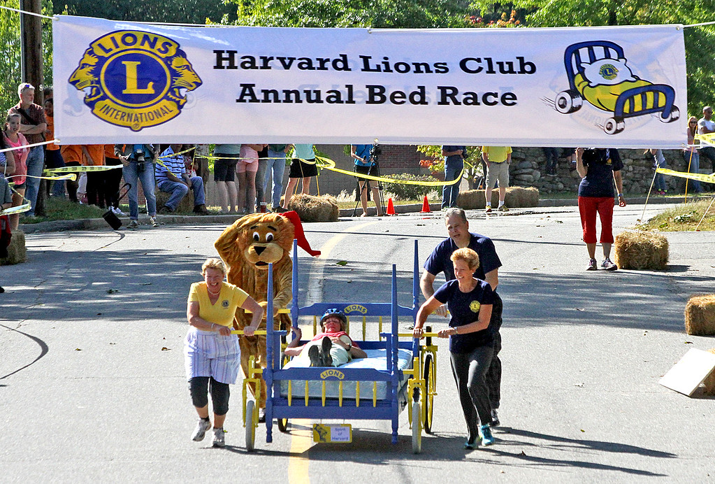 . Lions Club Team makes the last lap to the finish line in the annual Lions Club Bed Races. Nashoba Valley Voice Photo by David H. Brow
