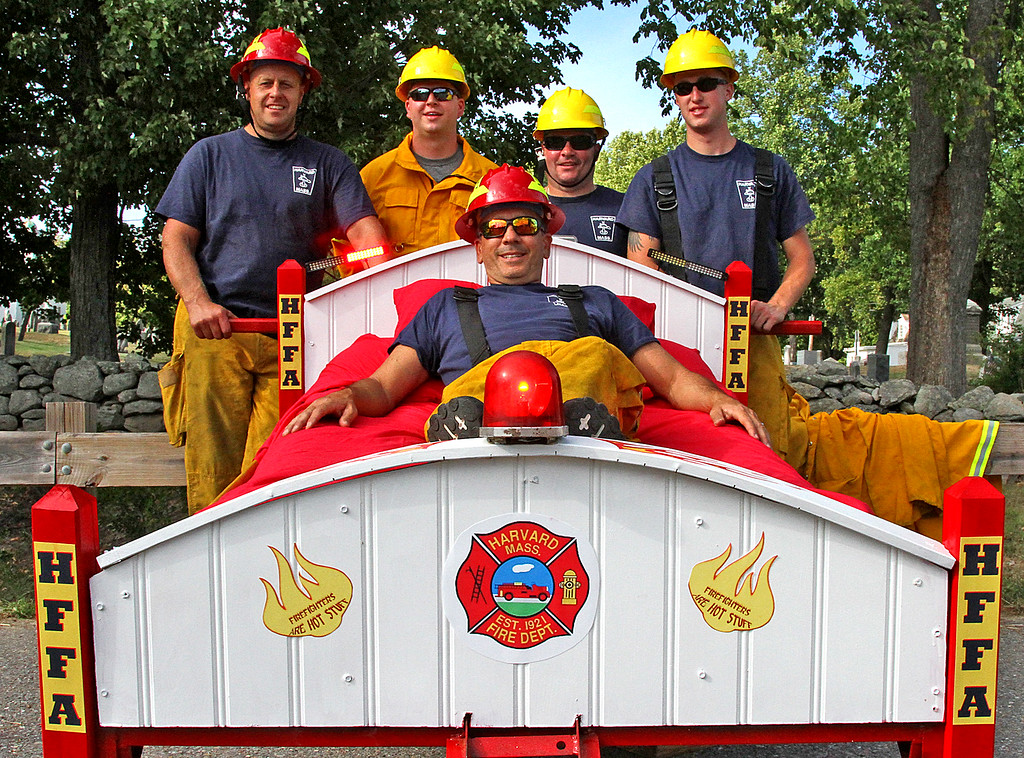 . Members of the Harvard Fire Dept., and the FireBalls Team, take a rest after the end of the races, laying on the bed is Lt. Bill Barton, standing in back L-R, Lt. Greg Harrod, FF Zach Clements, FF Adam Hughes and FF Justin Warren. Nashoba Valley Voice Photo by David H. Brow