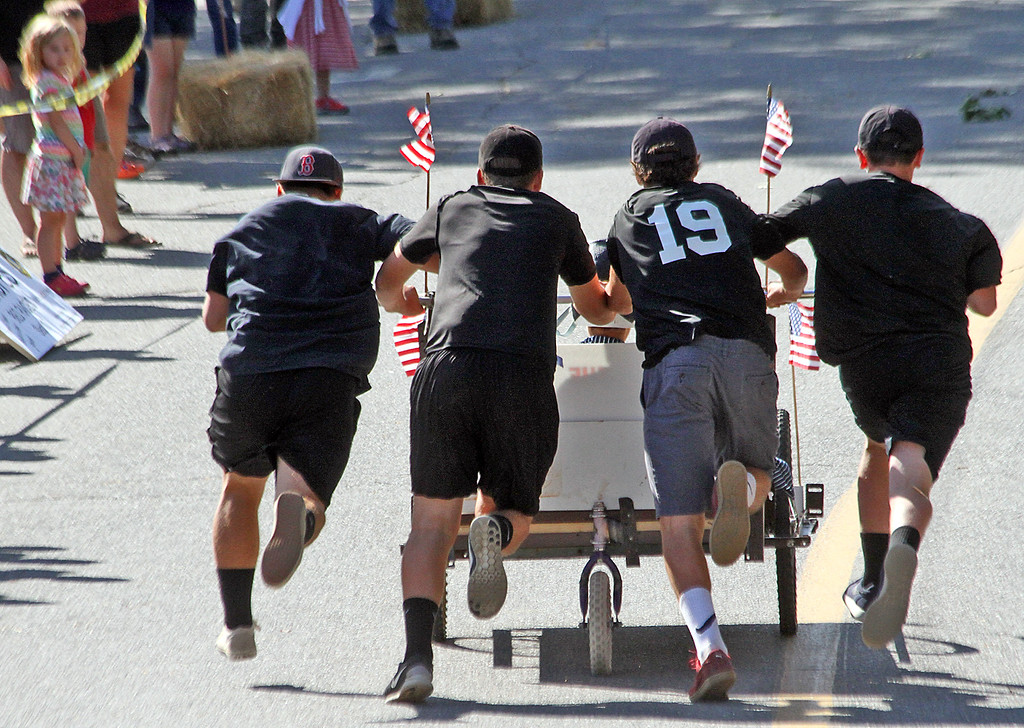 . Bed Race team heads out in a flurry during the annual Bed Races put on by the Harvard Lions Club. Nashoba Valley Voice Photo by David H. Brow