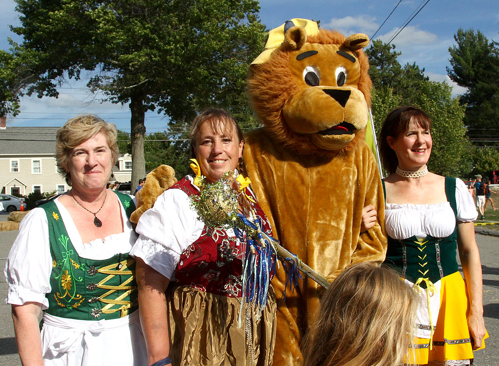 . Dressed in German outfits and with the Lions Club mascot (played by Joe Gaffney), is L-R, Sue Reedich, Kathleen Walh and Tina Ashley. Nashoba Valley Voice Photo by David H. Brow