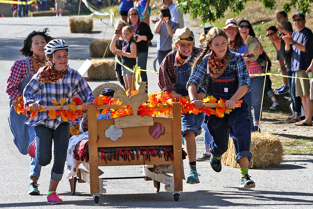 . The Winnie-The-Pooh Team in the last leg of the race for the finish. Nashoba Valley Voice Photo by David H. Brow