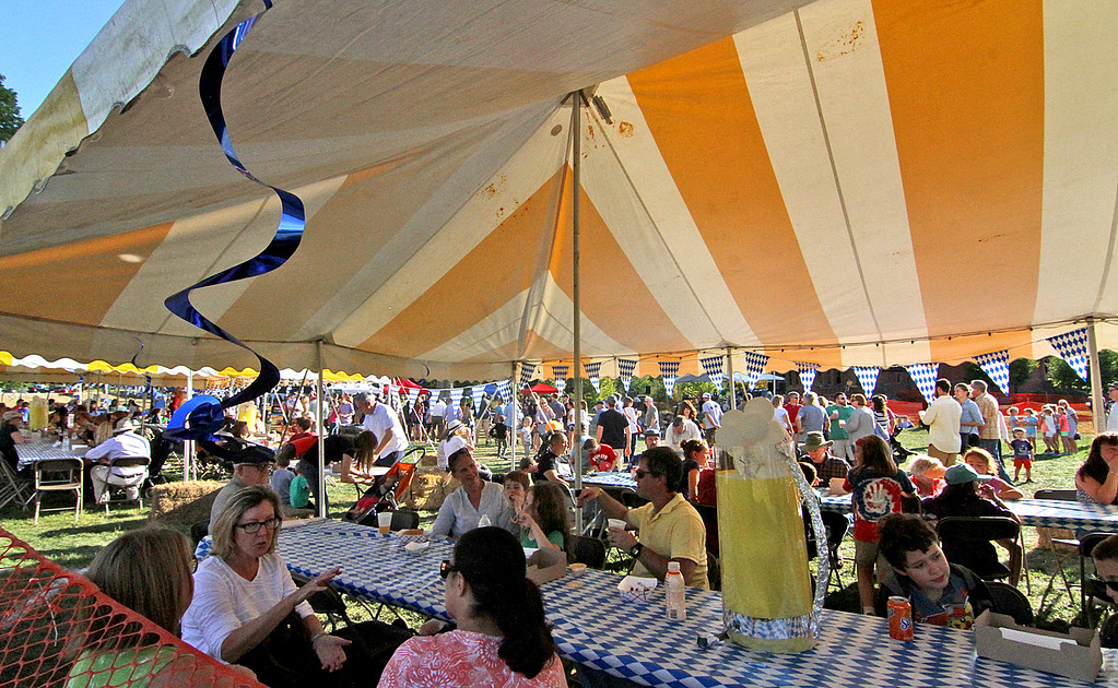 . Large group in attendance as seen at one of the food tents. Nashoba Valley Voice Photo by David H. Brow