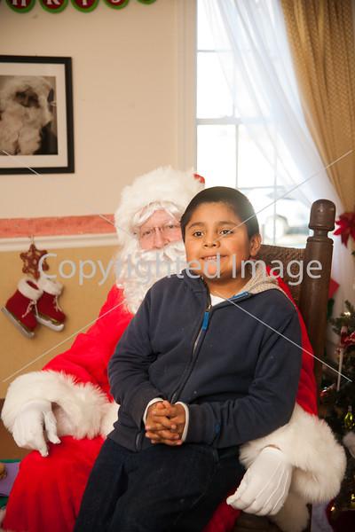 Charlie Eiland sits with Santa.